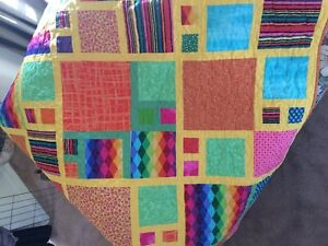 Quilt in bright 100% cottons