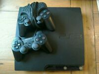 PlayStation 3 PS3 with controllers & games