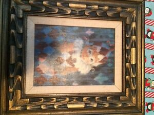 Antique clown painting framed.