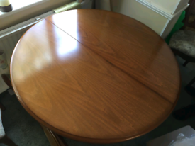 Hard wood extendable round/oval dining table and six matching chairs