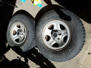 2 Jeep tires and rims