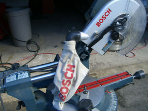 Bosch. Dual bevel,sliding miter saw. Scie à onglets coulissante