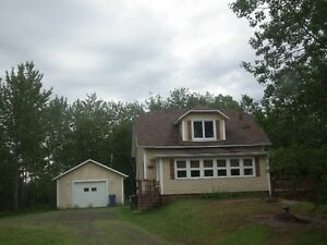 Pointe-Verte, NB. Country style home with land to waterfront.