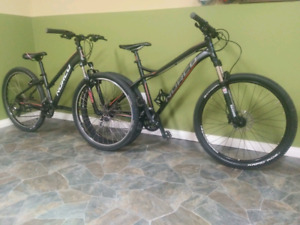 His and hers Norco mountain bike package