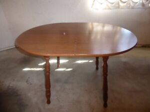1 – OVAL SHAPED MAPLE TABLE.