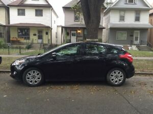 *PRIVATE SALE* 2012 Ford Focus hatchback (with winter tires!)