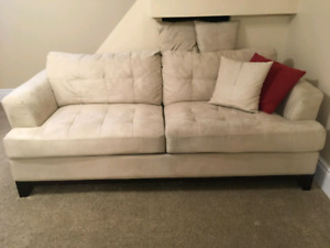 Cream coloured couch and love seat