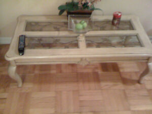 Solid wood tables with metal art and glass