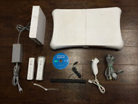 White nintendo wii console with two remotes and Balance board