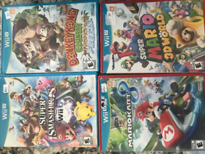 Wii u with box and games