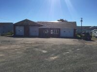 4  bay garage  with side  rental income  1 acres in prime  land