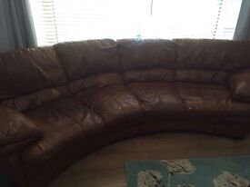 Large leather curved corner sofa, armchair and foot stools