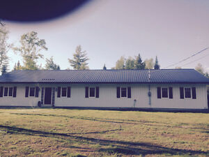 One level living 14 acres and camp