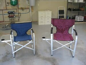 Two folding lawn chairs with side tables
