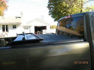 tri-fold tonneau cover for ram 1500 5FT. 7In Kawartha Lakes Peterborough Area image 3