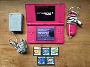 Matte pink Nintendo DSi with games