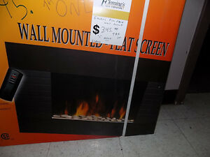 Fire Place Wall Mount $ 349.00 TAX INCL> Call 727-5344