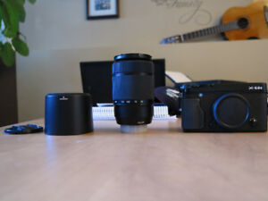 Fuji Film XE2s with 50-230 mm F4.5-6.7 OIS II, mint