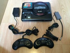 Sega Genesis 16-Bit console with 2 remotes and street fighter 2