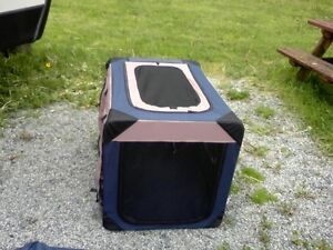 Medium soft-sided collapsible kennel Brand new.