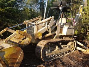John Deere 450 loader with detachable backhoe