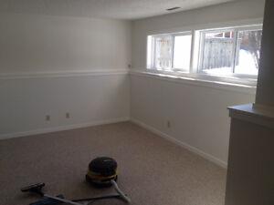 Large 2 bedroom, 2 bathroom basement suite in Sunnyside!
