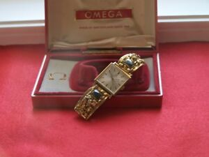 Omega watch with gold nugget band