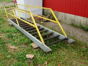 Steel stair case with hand rails