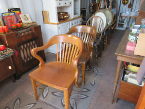 two antique w.krug solid oak court house lawyer chairs