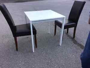 IKEA white kitchen/dining table with 2 leather chairs.