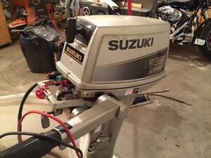 15HP Suzuki 2 stroke outboard for sale or trade for Canoe