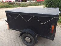 Car trailer with cover and drop down back
