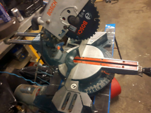 """Bosch 10"""" saw with all most brand new blade and stand"""