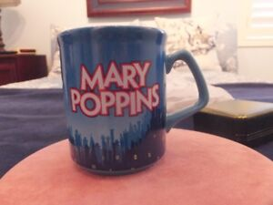 A COLLECTION OF THEATRE MUGS FROM BROADWAY SHOWS