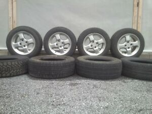 4 Mags, 8 used tires, 8 hubcaps for Volkswagen Jetta 1993-1999