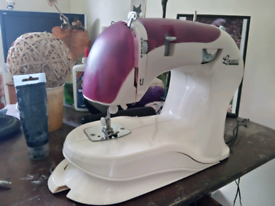 Sewing machine of the electronic kind,with a foot control