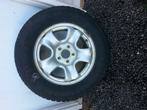 4 winter studded tires on rims 215/70/r16