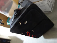 SUITCASE   with extandable handle.. black. practical, good