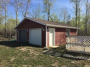 One acre with Garage and services, close to Lake