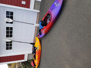 2 whitewater kayaks with accessories