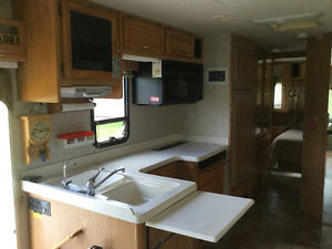 33 ft Dolphin motorhome with 12 ft pullout