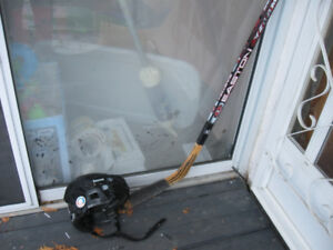 Youth right handed hockey stick and youth helmet
