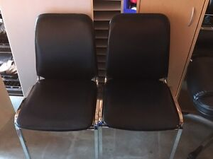 Black chairs ( stackable )