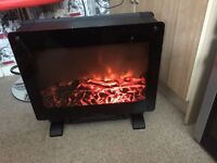 Electric fire free standing £30 has dimmer lights