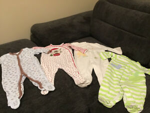 4 rompers and 40 bibs size 6 to 9 months