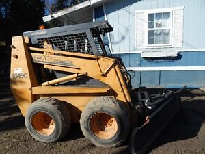 1845c Case skid steer with 5 attachments tire chains and trailer