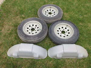 Three 12 inch trailer rims for sale