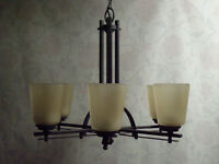 Contemporary Iron Chandelier with Carved, Tea-Glass Shades