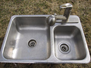 Double sink with faucet and soap dispenser