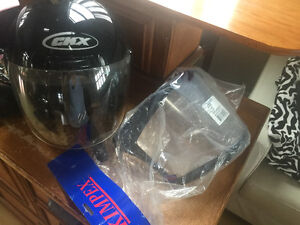 Motorcycle helmet CKX extra small with spare shield still in wra